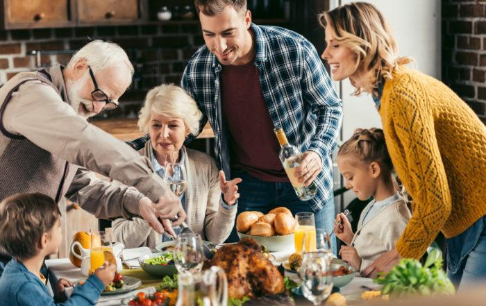 family generations holiday dinner table turkey